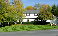 Lawn striping is achieved by bending grass blades in different directions to reflect sunlight.
