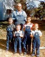 I'm the skinny guy at far left next to my little brother Tim. Our grandfather stands proudly behind us and our cousins Scott and Roger on his northern Illinois farm in the mid-1960s.